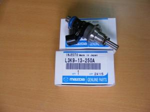 Форсунка топливная Мазда СХ7 L3K913250A
